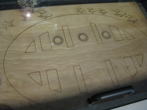 A peek at FabLab's laser cutter in action. 2014.