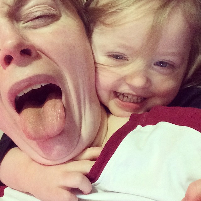 Toddler headlock/ a.k.a., what working from home looks like. Photo by Suzanne Skaar.