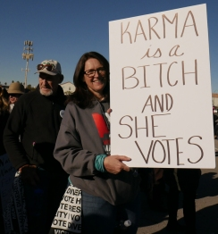 "Attendee holding sign at 2018 Las Vegas Women's Rally: ""Karma is a Bitch and She Votes."""