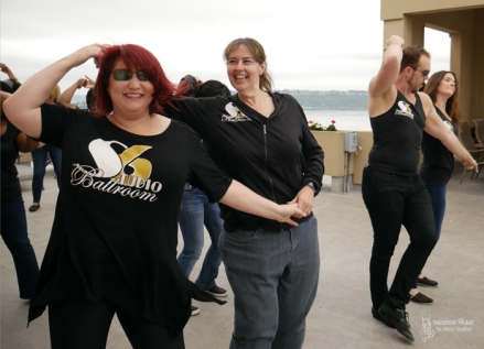 Studio 6 Ballroom dancers perform in a West Coast Swing flash mob on a roof top overlooking the water in Tacoma, WA. Photo by Suzanne Skaar: 2019. All rights reserved.